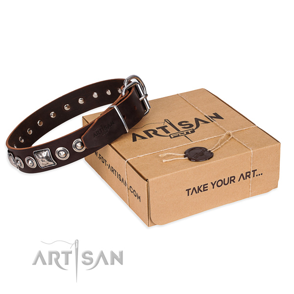 Leather dog collar made of soft to touch material with durable D-ring